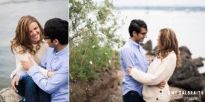couple snuggling during engagement photos