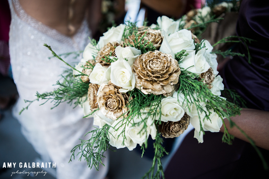 gold and white pinecone wedding bouquet