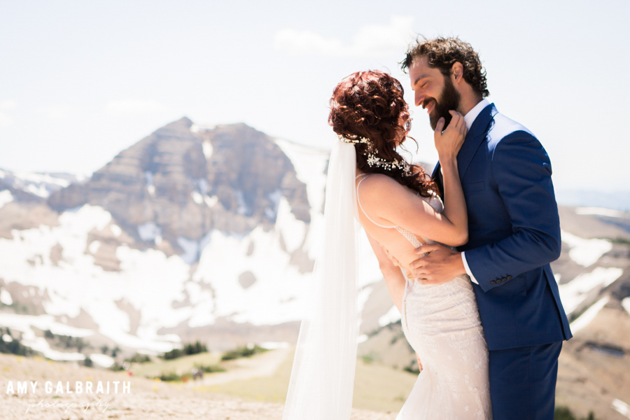 bride and groom on mountain with cody peak at jackson hole