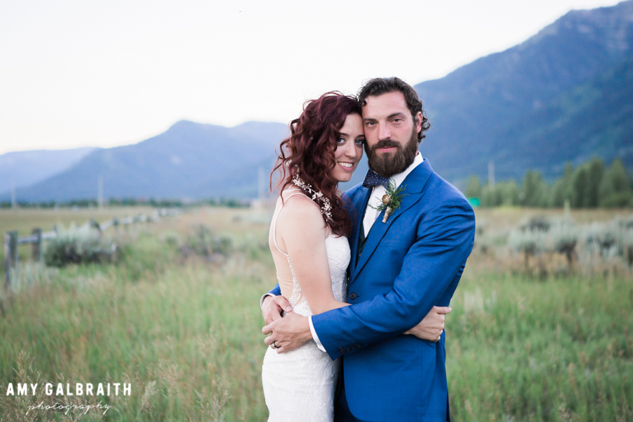 bride and groom with jackson hole mountains in the background