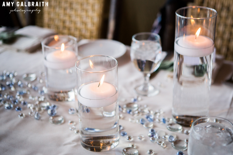 candles and blue crystals on wedding reception table