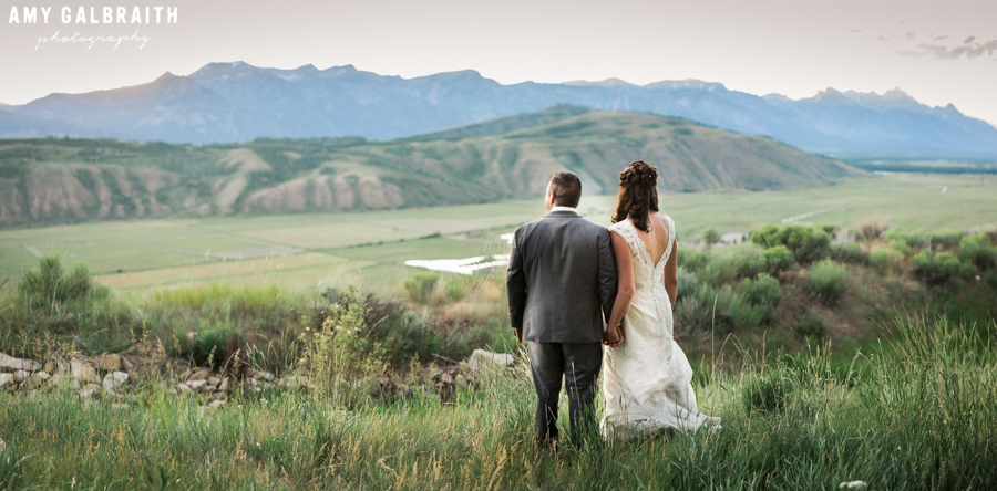 bride and groom enjoying views of the tetons from spring creek ranch