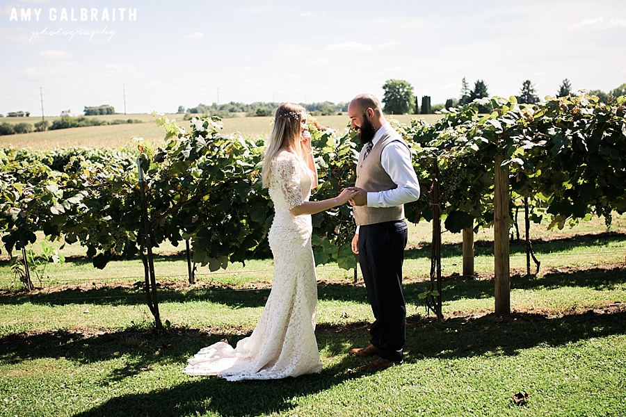 first look at groomsmen at over the vines