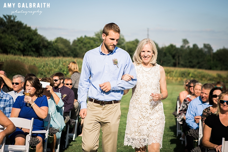 mother of bride walking down aisle at over the vines