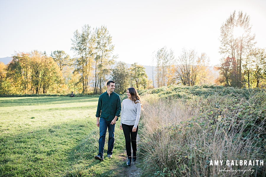 couple walking through golden fields in snoqualmie