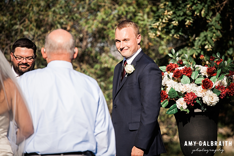 groom greets bride at end of aisle at boise wedding