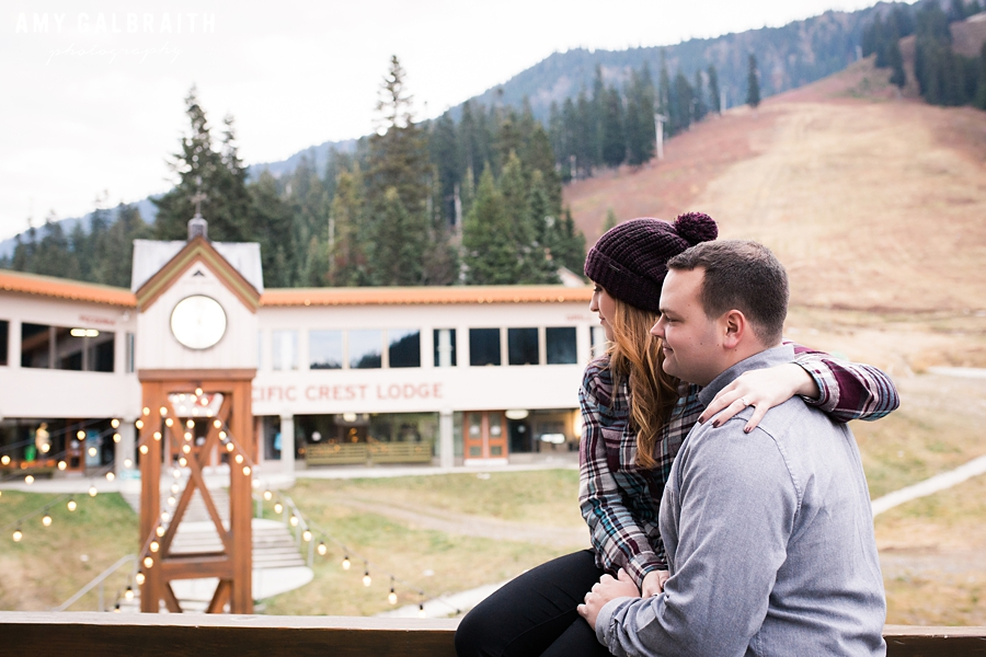 a couple sitting near the lodge at stevens pass