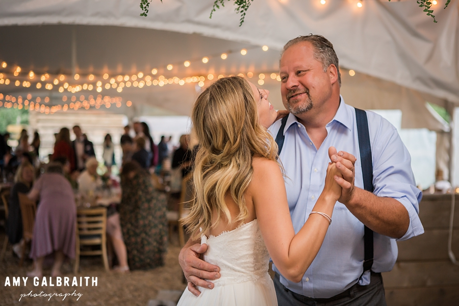 bride dances with her father at brown family homestead wedding