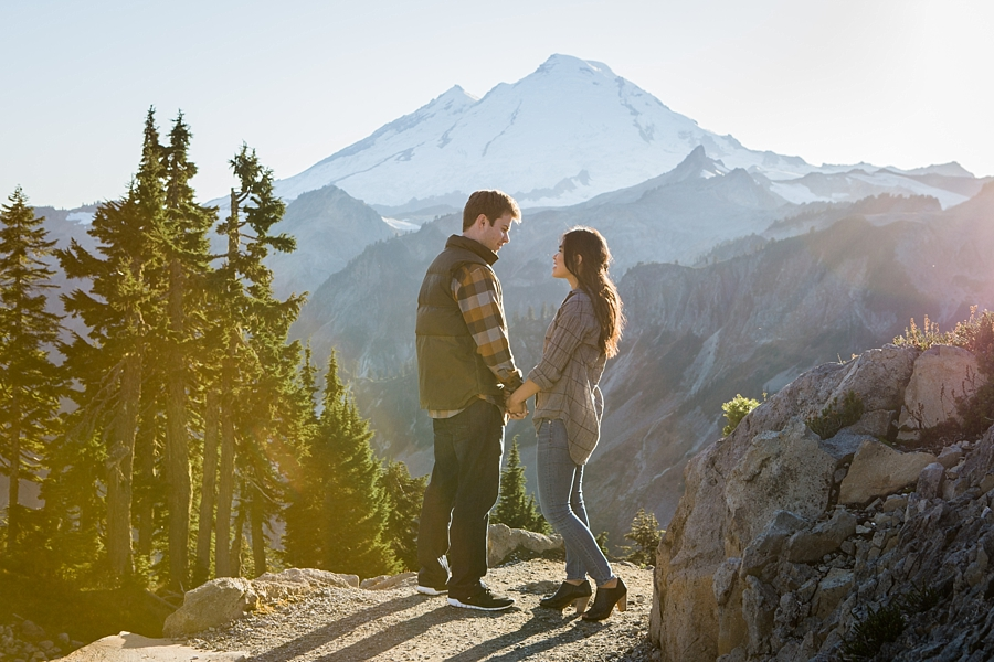 couple wearing plaid at mount baker during engagement session