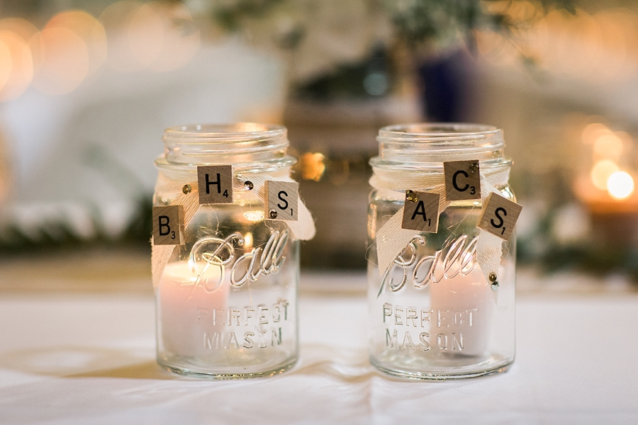mason jars with scrabble letters at wedding