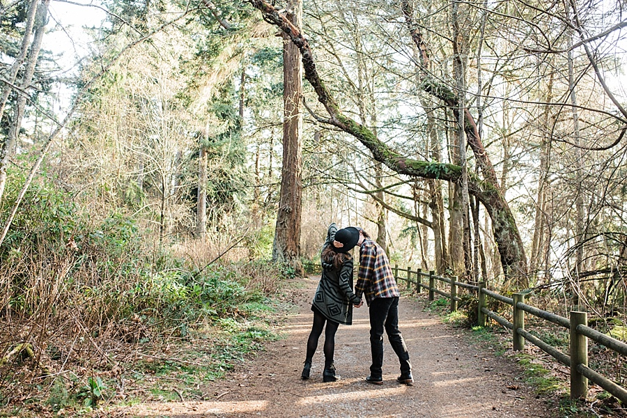 woodsy engagement photos in lincoln park in west seattle