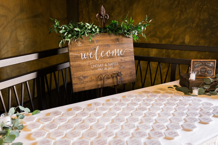 beautiful modern calligraphy sign on marble coasters and wooden welcome sign