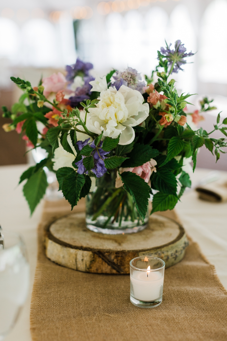 Colorful summer wedding centerpiece display by Flower by Chloe of Jackson Hole