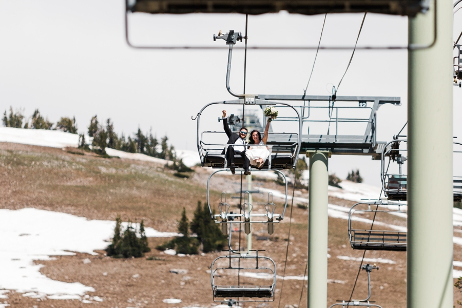 A bride and groom ride the chairlift to the base at Grand Targhee Resort on their wedding day