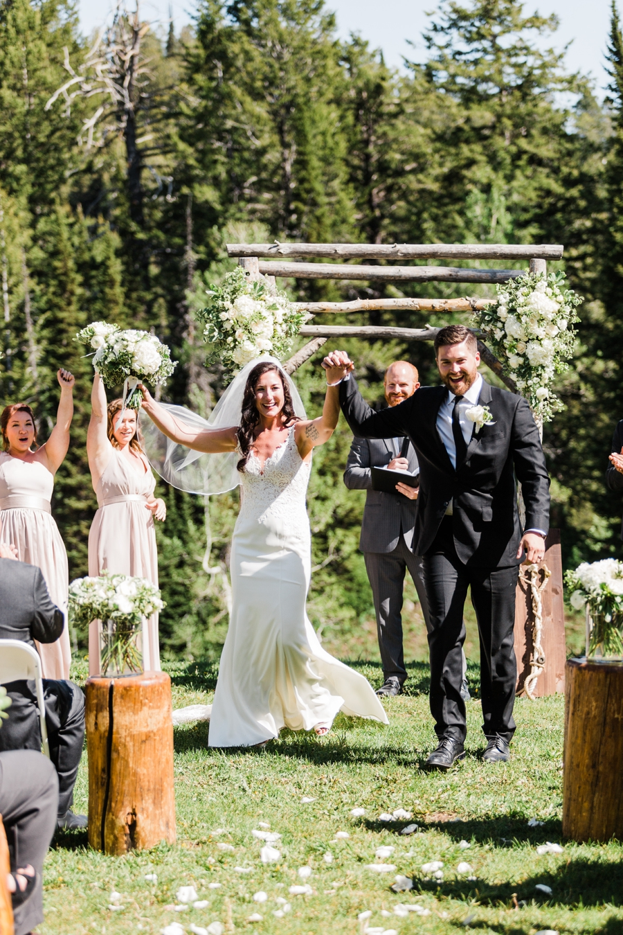 A bride and groom celebrate after their wedding ceremony at Grand Targhee in Wyoming