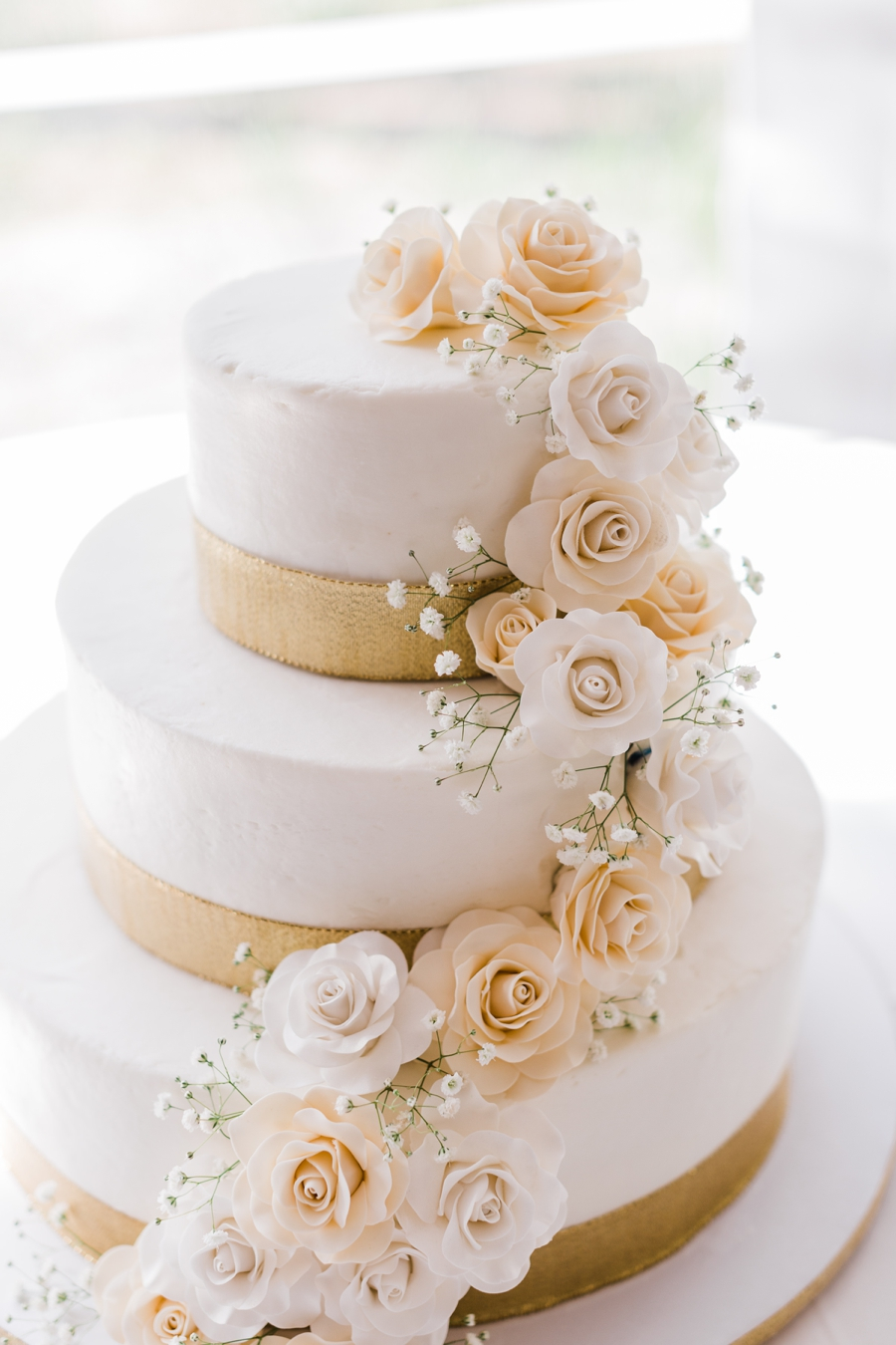 White and gold wedding cake by Sugar Shell in Jackson Hole