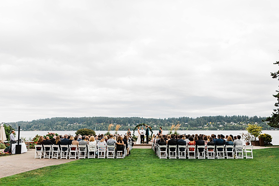 A wedding ceremony at Kiana Lodge, photographed by Seattle outdoor wedding photographer Amy Galbraith