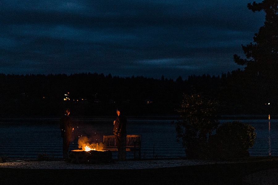 The firepit lit on the beach at Seattle-area wedding venue Kiana Lodge